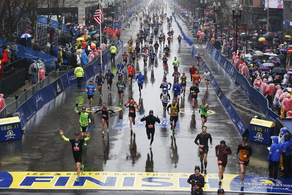 Boston, MA--4/16/2018-- Runners cross the finish line of the 122nd Boston Marathon. (Jessica Rinaldi/Globe Staff) Topic: Reporter: